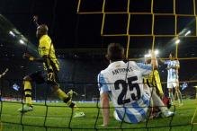Late goal drama leaves Dortmund dizzy, Malaga fuming