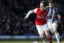 Tomas Rosicky double lifts Arsenal to fourth in EPL