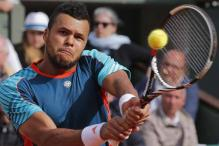 Tsonga beats Wawrinka to reach semi-finals