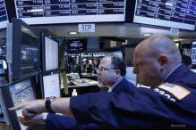 Drop in Apple shares, weak profits drag Wall Street lower