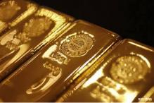 Gold holds near two-week high; equities cap gains