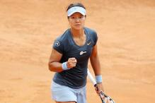 Li Na fights past Anabel Garrigues to reach second round in Paris