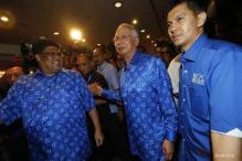 Malaysia coalition extends rule in tight election