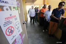 Malaysians vote in record numbers, ruling party ahead