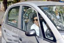 Snapshot: No luxury car here, Mandira Bedi drives a Nano to an event
