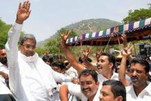 Cong savours Karnataka win, tussle for CM post continues