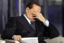 Dancer says showgirls dressed as Obama, nuns at Berlusconi party