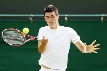 Bernard Tomic advances with win over James Blake at Wimbledon