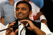 Ghaziabad: UP CM Akhilesh distributes free laptops to students