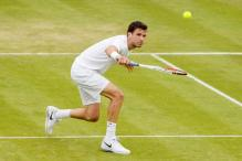 Zemlja beats Dimitrov to enter third round at Wimbledon