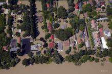 Record floods reach Budapest, Suzuki halts plant