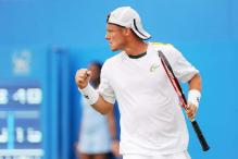 Lleyton Hewitt rallies past Michael Russell in Queen's 1st round
