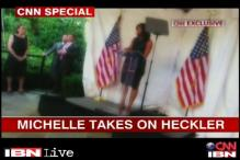 Michelle Obama loses her cool after protestor interrupts her speech