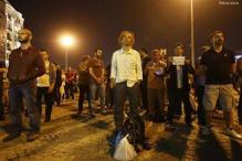Dozens arrested in Turkey, silent protester goes viral