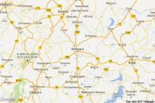 Two persons killed as truck rams into goods train