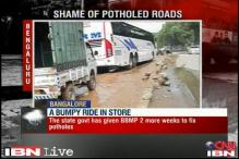 Bangalore: BBMP fails to repair potholed roads, commuters suffer