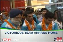 Victorious Indian boxing team arrives home