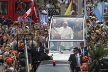 Huge crowds in Brazil welcome Pope Francis back to home continent