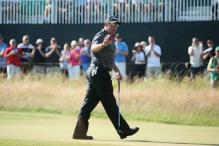 Woods makes solid start, Westwood on the charge