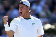 Hewitt wins opener at rain-delayed Atlanta event