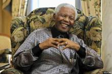 Obamas tour Mandela's island jail