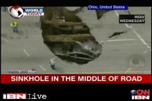 US: Sinkhole swallows car in Ohio, driver rescued using a ladder