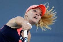 Top-seeded Radwanska eases into Stanford quarters