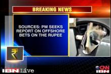 PM, advisors take lead in fighting rupee slide: sources