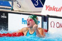 Ruta Meilutyte breaks 100m breaststroke world record in Barcelona