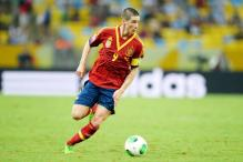 Spain will return to win World Cup: Torres