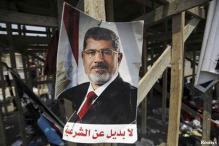 Egypt forces assault protest camp, many scores shot dead