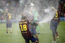 Valdes holds off Atletico as Barcelona claim Super Cup