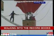Watch: China man's 18 metre tightrope walk between 2 hot air balloons