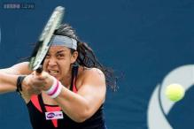 Wimbledon champion Bartoli out of Rogers Cup due to injury