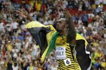 Usain Bolt wins men's 100 amid steady rain