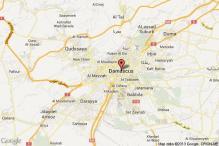 Car bomb in Damascus suburb kills 18