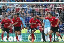 Cardiff stun Manchester City 3-2, Tottenham beat Swansea 1-0