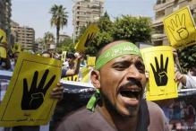 Clashes reported as thousands of Morsi supporters march in Egypt