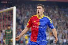 Basel, Lyon hold nerve to reach Champions League play-offs