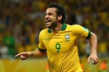 Brazil striker Fred's ban halved by appeals panel