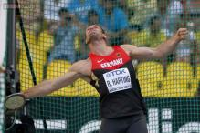 Robert Harting wins 3rd straight men's discus at World Championships