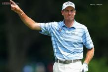 Furyk seizes PGA lead with 65, Woods at 71