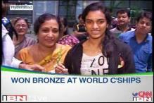 Bronze medallist PV Sindhu returns home