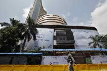 Sensex slumps nearly 450 points as rupee hits record low