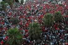 Thousands of Tunisians call on government to resign