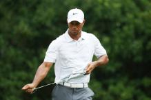 Woods to play with Bradley, Love in PGA Championship