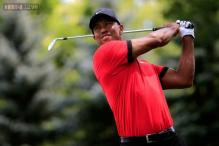 Tiger Woods coasts to seven-shot win at Bridgestone Invitational