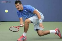 Bernard Tomic digs deep to win tough US Open clash