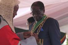 Zimbabwean President threatens British, US firms over Western sanctions