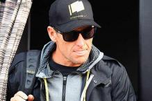 Lance Armstrong returns Sydney Olympic medal to officials